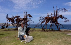 Harrie Fasher with her biggest sculpture to date, The Last Charge, at Sculpture by the Sea in Bondi, Australia, 2017. Image courtesy of Sculpture by the Sea.