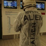 The Mystic Alien contemplates the timetables at Town Hall station